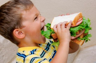 Boy Eating Huge Sandwich