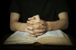 bigstock-hands-praying-on-bible-60692468-640x426